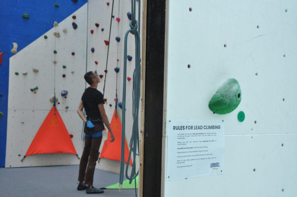 man climbing in upwall